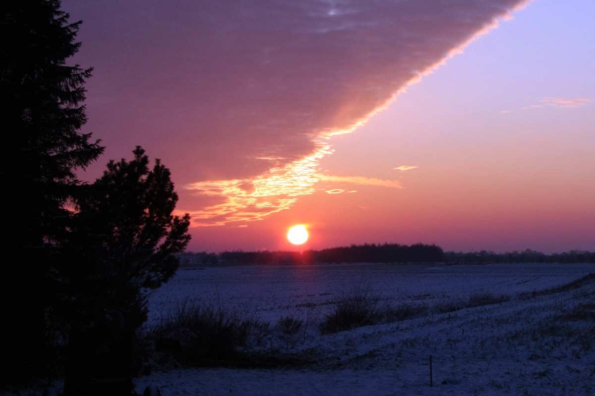 lichtpuntje_vlakte_zonsondergang